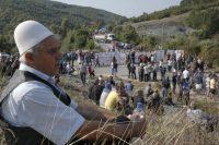 A man sits at a roadblock in Vojtesh, Kosovo, on Sept. 9. (Visar Kryeziu/AP)