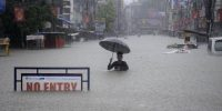 Indian monsoon flooded street. ARINDAM DEY/AFP/Getty Images