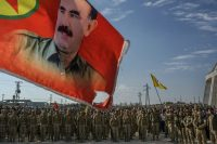 A flag depicting Abdullah Ocalan, founder of the Kurdistan Workers' Party, at a militia fighter's funeral in Kobani, Syria.CreditCreditMauricio Lima for The New York Times