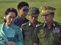 Aung San Suu Kyi, left, Myanmar's foreign minister and de facto leader, walks with Senior Gen. Min Aung Hlaing, Myanmar's commander in chief, in Naypyidaw, Myanmar, on May 6, 2016.