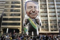 Supporters of Jair Bolsonaro, the far-right Brazilian presidential candidate who was stabbed during a recent campaign event, rally around an inflatable likeness of him in Sao Paulo on Sept. 9. His condition is serious but stable. (Andre Penner/AP)