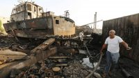 Workers inspect damage at the site of an air strike on the maintenance hub at the Hodeida port on 27 May, 2018. Abduljabbar Zeyad/REUTERS