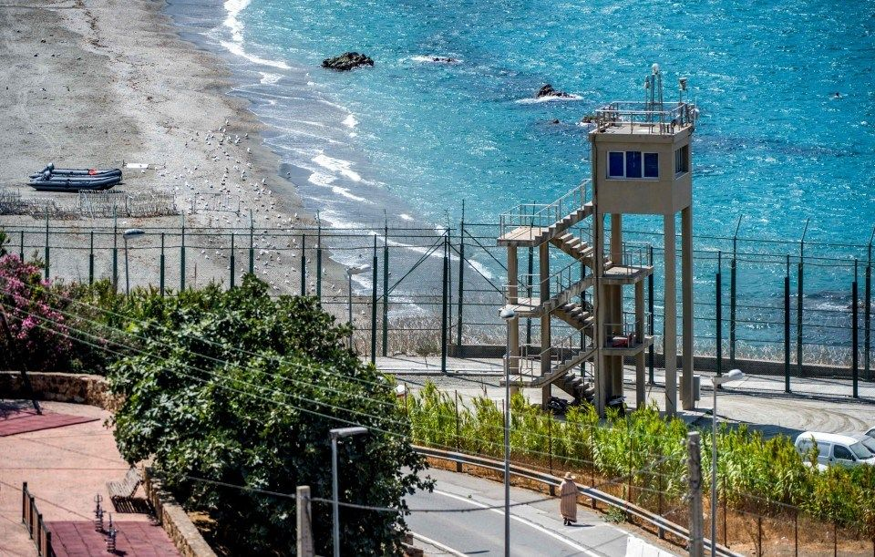 A guard tower overlooking the border fence encircling Spain's North African enclave of Ceuta, which lies on the Strait of Gibraltar, surrounded by Morocco. (Fadel Senna/AFP/Getty Images)