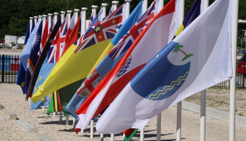 Flags outside the meeting of the Pacific Islands Forum in Nauru in September. Photo: Getty Images.