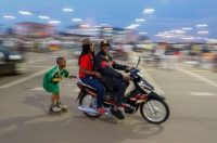 A Cameroonian couple on a scooter tow a boy on roller skates on the fringes of an campaign rally for Joshua Osih, the candidate of the Social Democratic Front, an opposition party to President Paul Biya in the capital Yaounde, Cameroon, on Friday. (Nic Bothma/EPA-EFE)