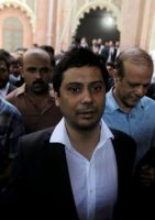 Cyril Almeida, a Pakistani journalist, walking into court in Lahore, Pakistan, for a hearing on treason-related charges on Oct. 8.CreditCreditMohsin Raza/Reuters