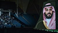 A portrait Mohammed bin Salman appears during a show at the King Fahad stadium in Riyadh as a part of celebrations of Saudi National Day on 23 September. Photo: Getty Images.