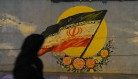 An Iranian flag painted on a wall in Tehran. Photo: Getty Images.
