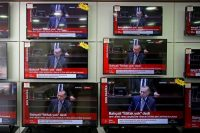 Television screens in Turkey show President Recep Tayyip Erdogan briefing Parliament on Tuesday on the case of Jamal Khashoggi.CreditCreditErdem Sahin/EPA-EFE, via Rex