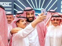 Crown Prince Mohammed bin Salman posing for a selfie at a business conference in the Saudi capital, Riyadh, on Tuesday.CreditCreditBandar Al-Jaloud/Agence France-Presse — Getty Images
