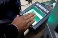 A woman going through the process of finger scanning for the Unique Identification (UID) database system, also known as Aadhaar, at a registration centre in New Delhi, India, last January.CreditCreditSaumya Khandelwal/Reuters