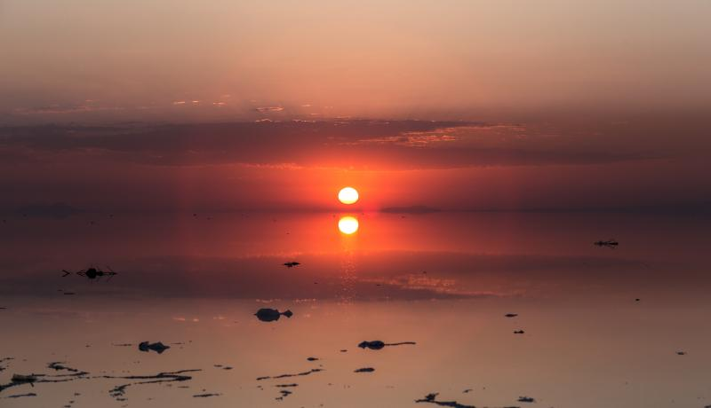 Sunrise over Urmia lake in the north-west region of Iran. Urmia lake has shrunk 80 per cent over the last 30 years due to climate change. Photo: Getty Images