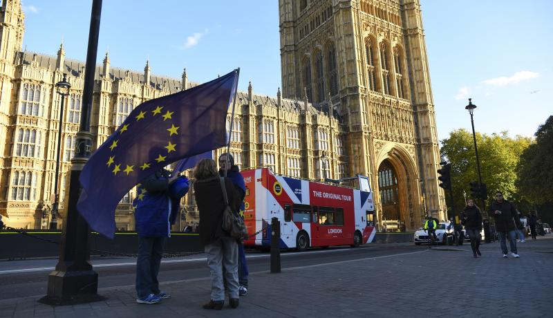 People wave an EU flag outside Parliament in Westminster. Photo: Getty Images.