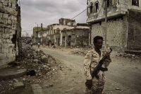 A militiaman patrols in Mocha, a Yemeni city close to the front line in the war between northern Shiite rebels and the government of President Abed Rabbo Mansour Hadi. (Lorenzo Tugnoli for The Washington Post)
