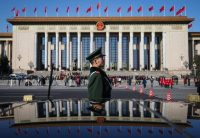 A Chinese soldier stands guard in front of the Great Hall of the People in Beijing. Mar. 5, 2017. (Roman Pilipey/European Pressphoto Agency)
