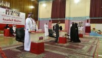 Bahraini election officials wait for voters at a polling station in Manama. Photo: Getty Images.