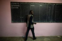 An electoral official counts ballots at a polling station in Yaounde, Cameroon, in October. (Nic Bothma/EPA-EFE/REX)