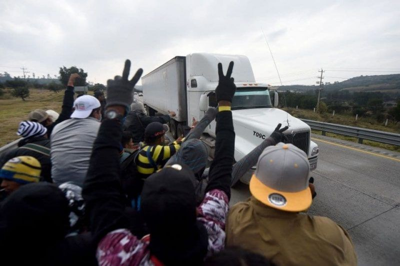 Migrants from Central American countries head toward Queretaro after leaving Mexico City to continue their trek north on Saturday. (Alfredo Estrellad/AFP/Getty Images)
