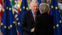 Michel Barnier greets Theresa May at the European Council summit in March. Photo: Getty Images