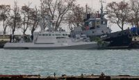 Seized Ukrainian military vessels in the port of Kerch on 26 November. Photo: Getty Images.