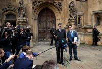 The pro-Brexit, Conservative lawmaker Jacob Rees-Mogg speaking to the media outside the Houses of Parliament on Thursday.CreditCreditMatt Dunham/Associated Press