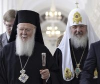 Ecumenical Patriarch Bartholomew I of Constantinople, left, and Russian Orthodox Patriarch Kirill tour the Kremlin in May 2010. The Russian Orthodox Church warned Sept. 28 that it would sever ties with the leader of the worldwide Orthodox community if he grants autonomy to Ukraine's Orthodox Church. (AP)