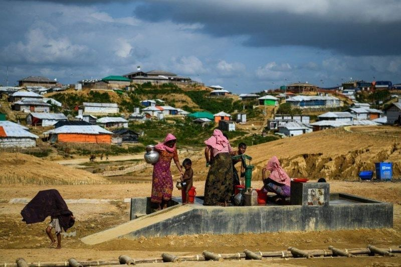 Rohingya refugees collect water at the Kutupalong refugee camp in Ukhia, Bangladesh, on Aug. 8. (Chandan Khanna/AFP/Getty Images)