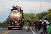 Honduran migrants in a caravan heading toward the United States walk from San Pedro Tapanatepec to Santiago Niltepec, Oaxaca State, Mexico, on Tuesday. (AFP/Getty Images)
