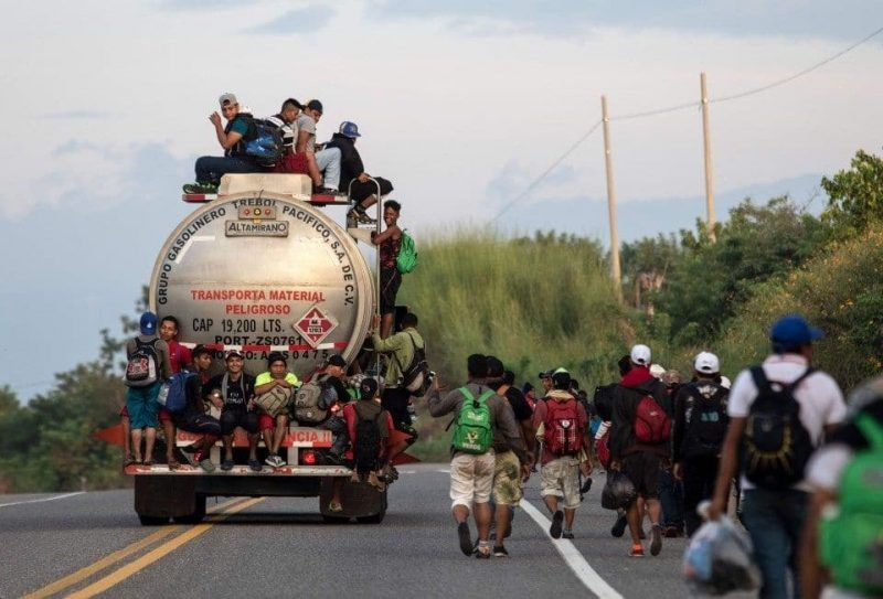 Honduran migrants in a caravan heading toward the United States walk from San Pedro Tapanatepec to Santiago Niltepec, Oaxaca State, Mexico, on Tuesday. (AFP/Getty Images)