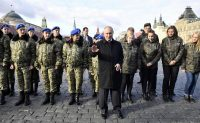 President Vladimir Putin poses with cadets after a ceremony in Moscow's Red Square.CreditCreditAlexander Nemenov/Agence France-Presse — Getty Images
