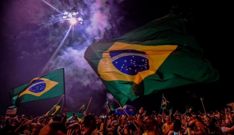 Supporters of Jair Bolsonaro celebrate his election win in Rio de Janeiro. Photo: Getty Images.