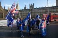 Anti-Brexit demonstrators wave British Union flags, also known as Union Jacks, and European Union flags outside Parliament in London on Wednesday. (Chris Ratcliffe/Bloomberg News)