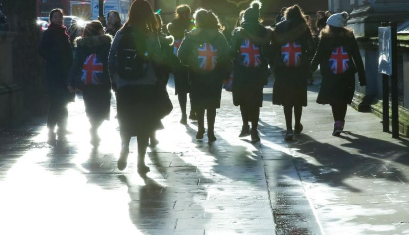 People with Union Flag backpacks in Whitehall on 19 December. Photo: Getty Images.