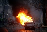 A car burning near the Champs-Élysées during a demonstration in Paris on Saturday.CreditCreditKamil Zihnioglu/Associated Press