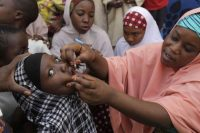 A health official administers a polio vaccine in 2014 in Nigeria, one of the few countries in the world where the wild polio virus remains endemic. (Sunday Alamba/Associated Press)