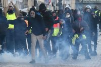 """Yellow vest"" protesters with riot police members in Marseille, France, on Saturday. (Boris Horvat/AFP/Getty Images)"