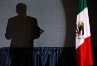 The shadow of Andrés Manuel López Obrador in July in his campaign headquarters in Mexico City. (Marco Ugarte/AP)