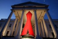 A large AIDS ribbon hangs from the North Portico of the White House in Washington, Nov. 30, 2007, in honor of World AIDS Day, which is officially marked around the world Dec. 1. (Ron Edmonds/AP)