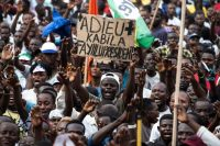 "A supporter of presidential candidate Martin Fayulu holds a sign saying ""Goodbye Kabila, Fayulu President"" at a campaign rally in Kinshasa, Congo, on Wednesday. (Stefan Kleinowitz/EPA-EFE/REX/Shutterstock)"