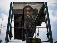 A billboard of the Democratic Republic of Congo's departing president, Joseph Kabila, was burned by supporters of the opposition leader Felix Tshisekedi.CreditCreditHugh Kinsella Cunningham/EPA, via Shutterstock
