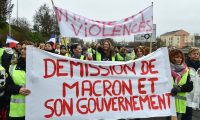 Gilets jaunes calling for Macron's resignation in Le Mans. 'Suggesting a tougher line on immigration could curb populism would be convincing only if it were a priority for citizens.' Photograph: Jean-François Monier/AFP/Getty