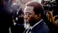 Joseph Kabila arrives at a polling station on election day, 30 December. Photo: Getty Images.