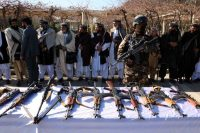 Former insurgents surrender their weapons during a reconciliation ceremony in Herat, Afghanistan, on Jan. 23. (Jalil Rezayee/EPA-EFE/Shutterstock)