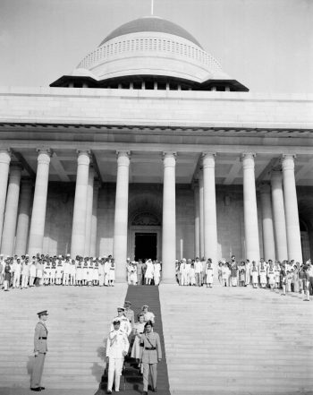 Earl and Countess Mountbatten, behind naval and military members of the governor-general's staff, walk down the steps of Government House in New Delhi, India, June 21, 1948.CreditCreditAssociated Press