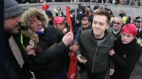 Guardian columnist Owen Jones is confronted by right-wing protesters after attending a demonstration in central London on January 12