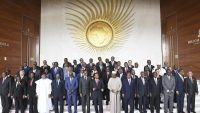 Africa Union Chairperson Paul Kagame (7thL) and Chairperson of the African Union Commission Moussa Faki (6thL) stand with heads of states and governments after a session of the Assembly of the African Union on 17 November 2018. Monirul BHUIYAN / AFP