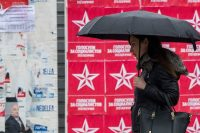 A woman walks past electoral campaign posters Friday in downtown Chisinau. (Dumitru Doru/EPA-EFE/REX/Shutterstock)