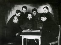 Felix Dzerzhinsky, center, who led the Bolshevik secret police, the Cheka, with a group of Chekists in 1923.CreditLaski Collection/Getty Images