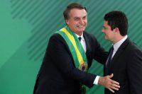 El presidente de Brasil, Jair Bolsonaro, junto a Sérgio Moro, su ministro de Justicia y Ciudadanía en Brasilia, el 1 de enero de 2019 Credit Eraldo Peres/Associated Press