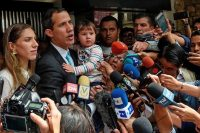 Juan Guaidó spoke to reporters in Caracas on Thursday, with his wife, Fabiana Rosales, left, and young daughter, Miranda.CreditCreditFederico Parra/Agence France-Presse — Getty Images